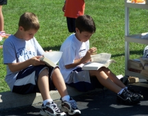 Boys reading the Bible